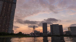 Time-lapse footage of cloudy sky over Tokyo cityscape at sunset, Tokyo, Japan Footage