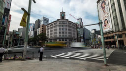 Time-lapse footage of people walking in front of Wako building in Ginza shopping Footage