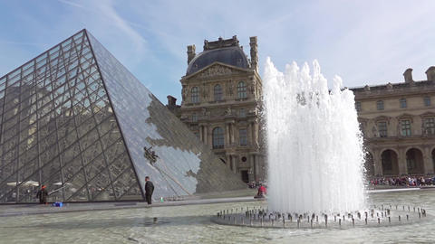 Panorama of Louvre Courtyard With a Fountain and a Glass Pyramid. Slow Motion Live Action