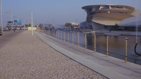 Doha cor-niche sunset summer shot showing National museum of Qatar (Desert rose) Live Action
