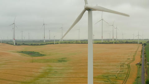 AERIAL: Wind Mill rotating by the force of the wind and generating renewable Live Action