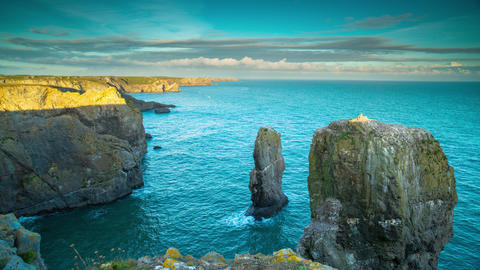 Loopable video of cliffs on coastline at sunset, Wales Live Action