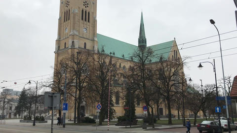 Lodz, Poland, A large clock tower towering over a city Live Action
