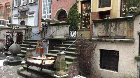 Gdansk, Poland, A building next to a fireplace Live Action