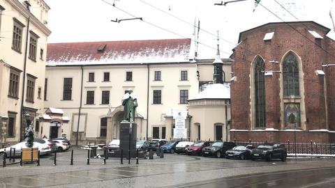 Krakow, Poland, A street with cars parked on the side of a building Live Action