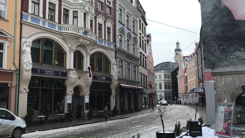 Riga, Latvia, A city street in front of a building Live Action