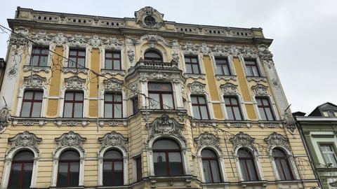 Lodz, Poland, A large stone building with a clock Live Action
