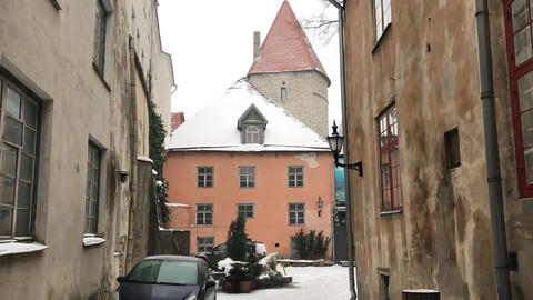 Tallinn, Estonia, A narrow city street with buildings on the side of a building Live Action