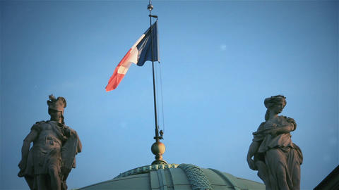 Flag of France over a Building in Paris Live Action