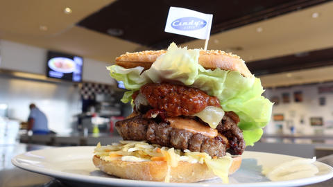 A huge and tasty burger at Cindy's fast food restaurant Live Action