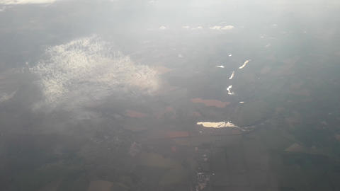 Panorama of clouds and earth from an airplane Live Action