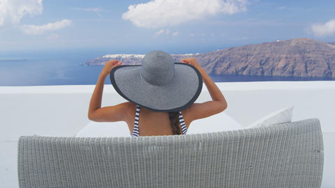 Vacation travel woman relaxing enjoying Santorini Live Action