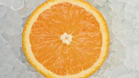 Fresh fresh orange slice over crushed ice Live Action
