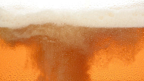 Close up background of beer with bubbles in glass Live Action