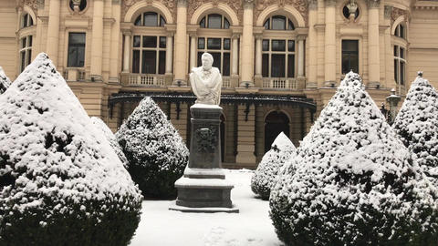 Krakow, Poland, A statue covered in snow in front of a building Live Action