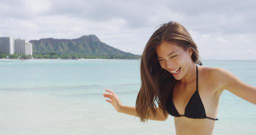 Playful Young Woman Running On Shore During Vacation At Waikiki Beach Live Action