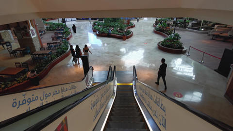 Mall of Qatar interior shot showing the escalator going down to the food court Live Action