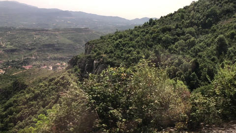 Montserrat, Spain, A tree with a mountain in the background ライブ動画
