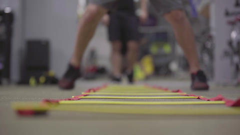 Unrecognizable sportsmen training speed and balance in sports club. Feet of Live Action