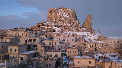 Uchisar Castle City in Cappadocia, Turkey. Drone Aerial View of Winter Landscape Live Action