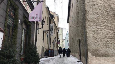Tallinn, Estonia, A person walking down a street Live Action
