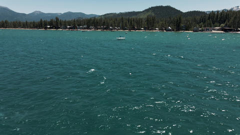4K Tahoe Lake flight above clear water Live Action