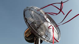 Metal fan with red strings attached Footage