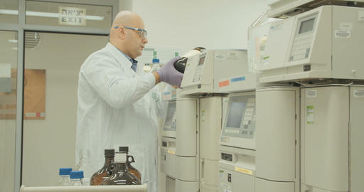 Lab technician working in a pharmaceutical laboratory Live Action