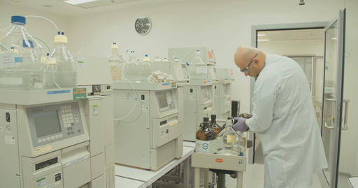 Lab technician working in a pharmaceutical laboratory Footage