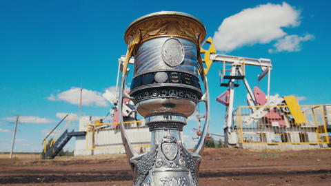 modern cup with Yuri Gagarin picture against pump jacks Live Action