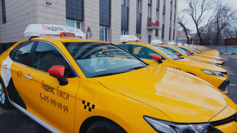 Yandex taxi cabs with signs on parking lot by cafe closeup ライブ動画