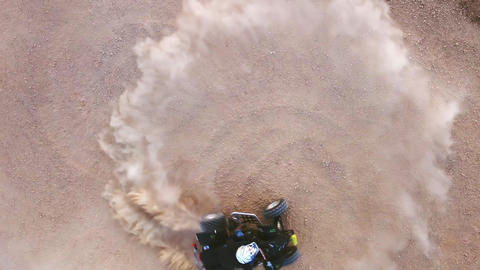Riding quad bike. Man in protective equipment and helmet, drifting on his ATV Live Action
