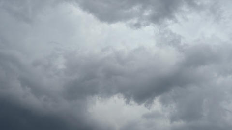 Dark, ominous, gray thunderclouds. Timelapse Live Action