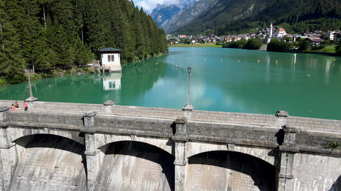 Alpin lake and dam in summertime, view from drone, Auronzo, italian dolomites Live Action