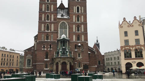 Krakow, Poland, A large clock tower towering over a city Live Action