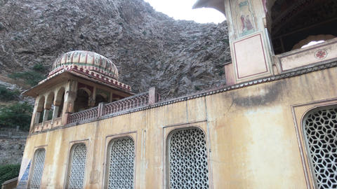 Jaipur, India - Galta Ji, monkeys jump on the eaves of an old structure Live Action