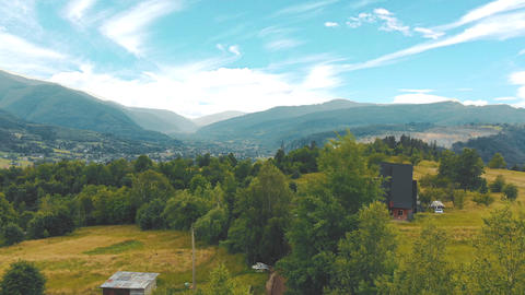 Aerial Flying over a forest of green trees. Background of green trees. Drone Live Action