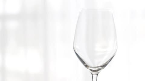 Empty wineglass indoors, wine glass for holiday drink and aperitif, background Live Action