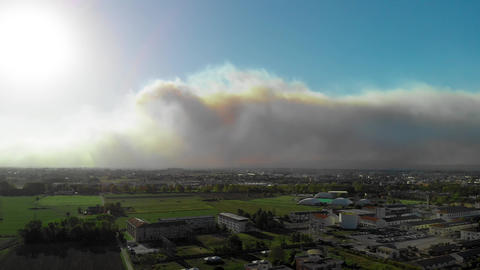 Aerial view of countryside with Arson. Smoke towards the sky, view from drone Live Action