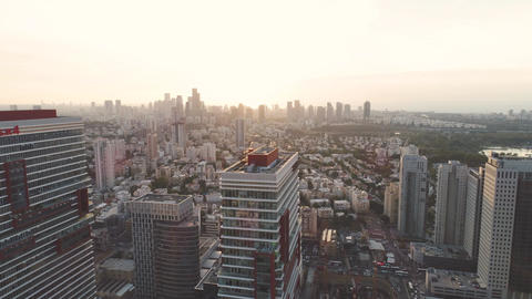 Tel aviv skyline at Daytime. Horizon view of towers and buildings towards sun Live Action
