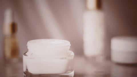 Face cream jar for healthy body care routine, skincare product at vintage spa Live Action