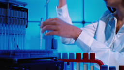 Microbiology Laboratory Scientist Works with Petri Dishes and test tubes for corona virus test Live Action