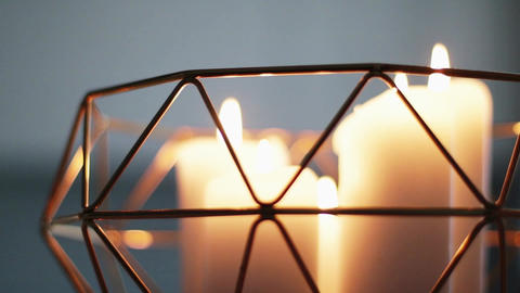 Candles inside golden decorative vase as luxury home decor, holiday time and Live Action