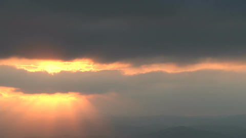 Time Lapse of sunset behind rain clouds Footage