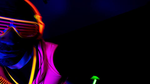 Person wearing neon clothes raving in club Live Action