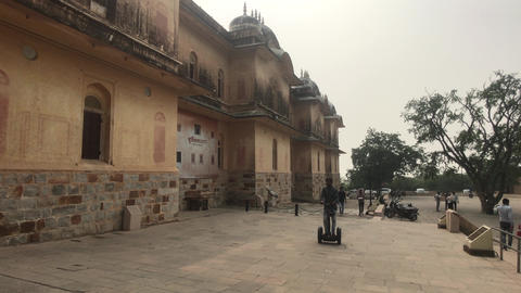Jaipur, India - November 05, 2019: Nahargarh Fort Tourist rides a scooter Live Action
