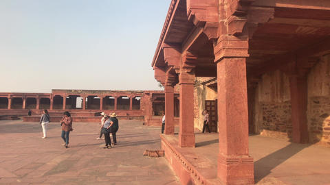 Fatehpur Sikri, India - November 15, 2019: Abandoned city tourists walk the Live Action