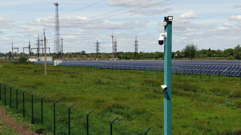Solar power station in the field, vegetation and the metal structures, 4k Live Action