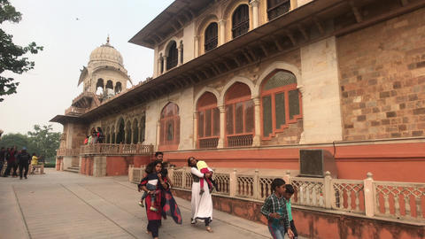Jaipur, India - November 03, 2019: Tourists walk along the building with Live Action