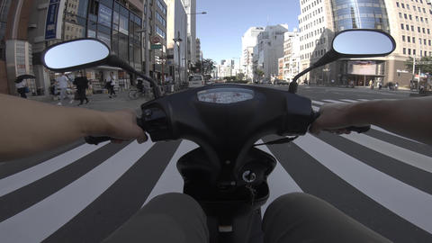 A point of view of driving by bike at Aoyama avenue in Tokyo Live Action